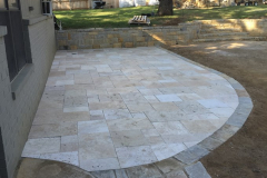 Travertine paver patio with Luder's stone boarder