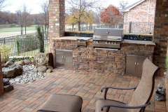 Out door kitchen with drop in grill faux rock