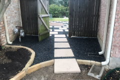 24 in_ x 24 in_ pavers with black Tejas gravel between (1)