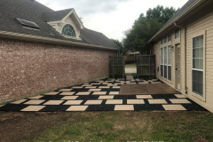 24 in_ x 24 in_ pavers with black Tejas gravel between (2)