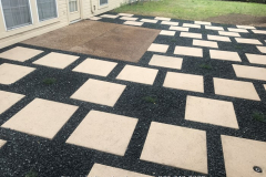24 in_ x 24 in_ pavers with black Tejas gravel between (3)
