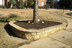 sand stone wall with flagstone cap